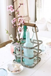 a holder with bottles and cherry blossoms is a cool idea with a vintage touch to the space