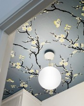 blooming branches on the ceiling make the space feel spring-like and very tender and fresh