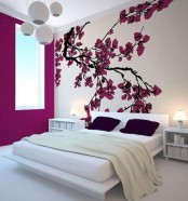 bright cherry blossom decor on the wall brings a strong spring feel to the bedroom and makes it bolder