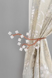 stylized cherry blossom branches as curtain holders – a little and cute accessory to spruce your home for spring