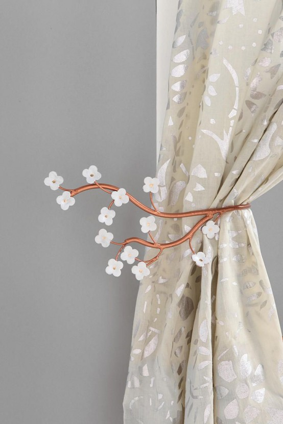 stylized cherry blossom branches as curtain holders - a little and cute accessory to spruce your home for spring