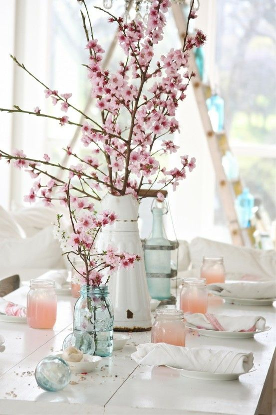 vases with pink cherry blossom are amazing as spring centerpieces or just table decor and they look fresh and romantic