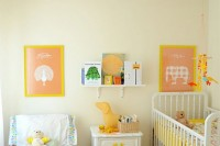 a warm-colored shared space done with touches of yellow, with artworks, toys and some bright bedding