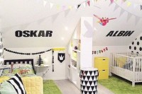 a bright shared space with yellow and green touches and some black and white patterns plus buntings for a cheerful touch