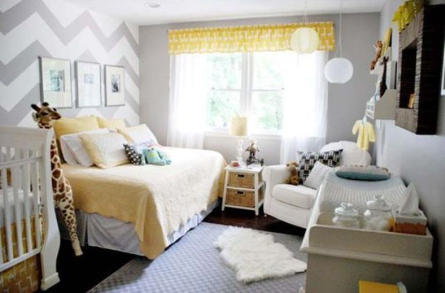 a neutral shared space with grey walls, a chevron print statement wall, touches of yellow and cozy rustic elements