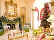 a refined and neutral Christmas living room with bold holiday decor – a colorful ornament garland, a Christmas tree with lights and bright ornaments, white deer figurines is lovely