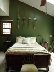 a vintage bedroom with dark wooden furniture, floral bedding, floral arrangements in vases and pendant lamps