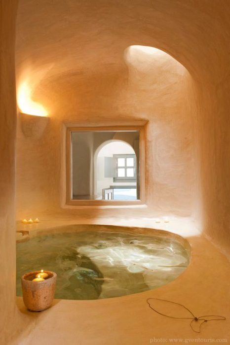 a gorgeous sunken bathtub or even a plunging pool seems to be cut out right in here and lit with a skylight