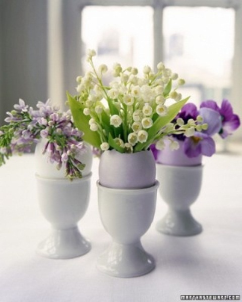 pastel eggs in holders with little spring flower arrangements are amazing for an Easter party