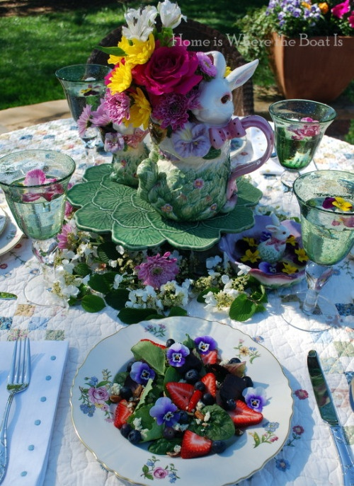colorful spring blooms arranged for an Easter party centerpiece and bunny figurines