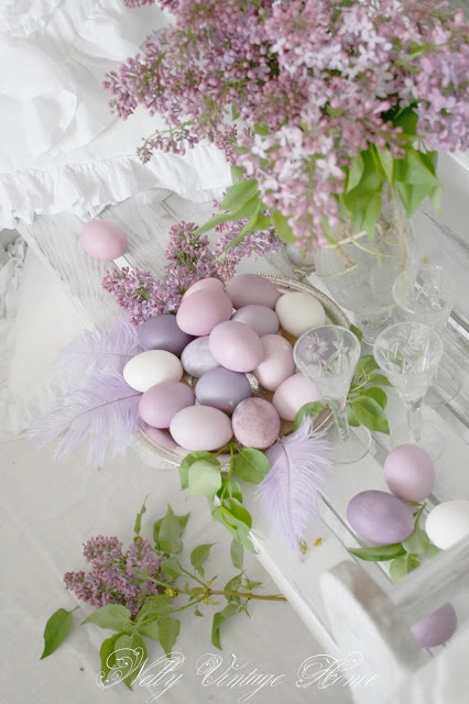 a tender lilac centerpiece and Easter eggs in matching purple and lilac shades