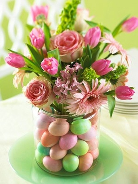 a bright floral arrangement with colorful eggs in the jar is a cool Easter decoration