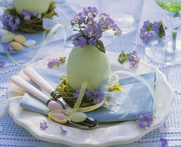 a pastel green egg with purple blooms will mark each place setting in a stylish way