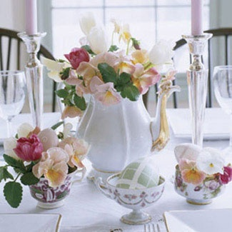 a vintage tea pot with white, pink and burgundy blooms and egg cupes with the same blooms