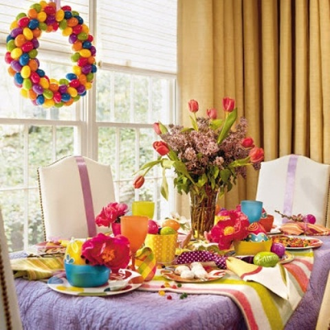 a colorful Easter centerpiece with red tulips and lilac for bright decor