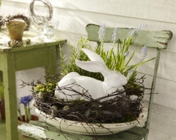 a bowl with some vine, greenery and a bunny on top for vintage Easter decor