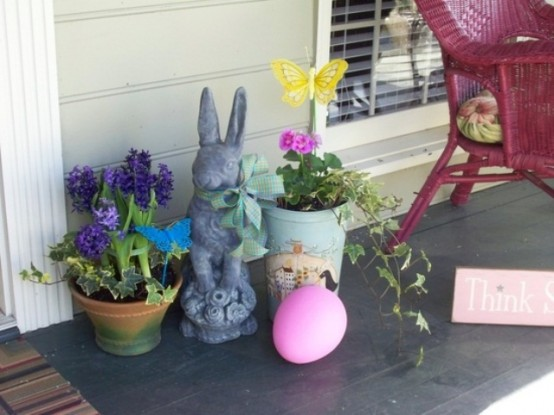 a cute Easter decoration with potted flowers, an oversized egg and a vintage-inspired bunny