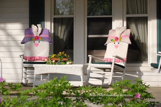 two rocking chairs with bunny covers and a bright floral arrangement for Easter