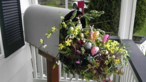 a mail box filled with greenery, bright blooms and branches is a cool porch decoration for Easter