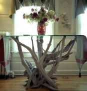 a pretty table of a driftwood base and a glass tabletop is a lovely idea for many spaces, in many styles and you can DIY it