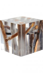 a clear resin side table with lots of branches and driftwood inside is a lovely idea to add a natural feel to the space