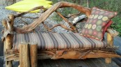 a pretty eco-friendly outdoor bench composed of driftwood with ligth staind, of a striped cushion and a prette pillow is a bold idea for outdoors