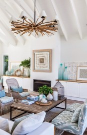 a unique beach chandelier made of driftwood and several small white lampshades is amazing for a coastal interior