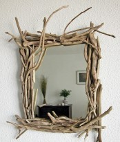 a mirror with a frame mad eof rough driftwood will add a coastal or beachy feel to your space, whatever it is