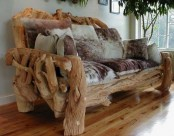 a unique sofa made of driftwood pieces and of faux animal skin cushions and pillows is a bold solution to rock