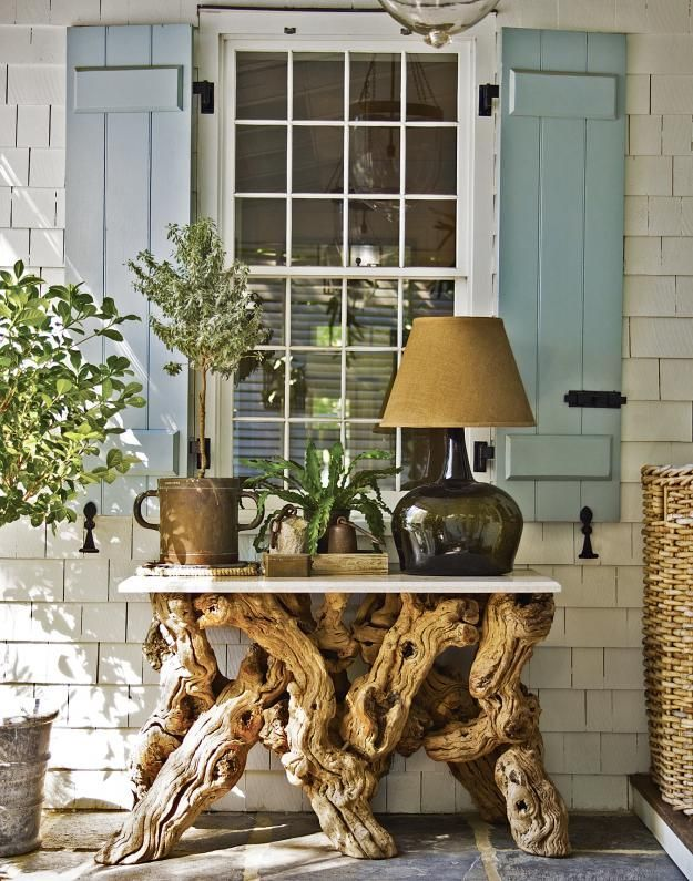 a console table made of a white tabletop and driftwood is a lovely idea to rock and you can use it in many spaces including outdoors