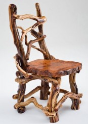 a creative chair made of wood slices and driftwood and stained dark looks creative and pretty and gives a rustic feel to the space