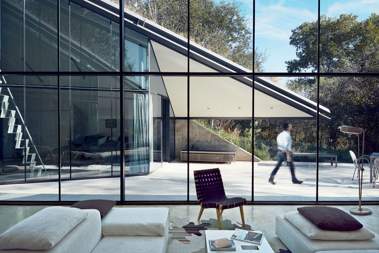 Picture Of edgy modern white home with two geometric–volumes  5