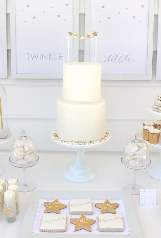 of elegant all white dessert table for a gender neutral baby shower