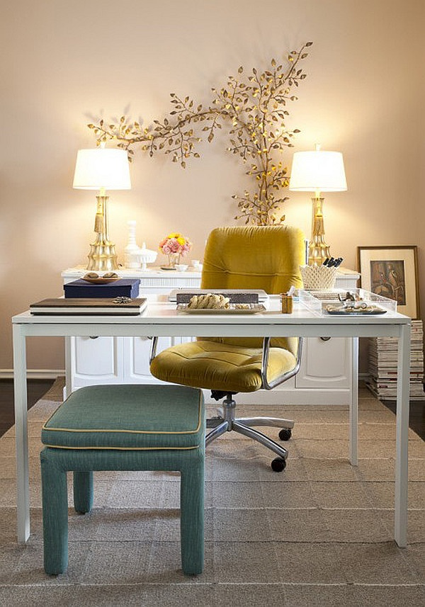 a refined feminine home office with a mustard velvet chair, a blue stool and a gorgeous botanical artwork on the wall