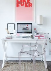 a modern feminine home office with a white desk, an acrylic chair, a bright poster and bright pink touches