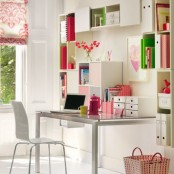 a colorful feminine home office in neutrals but with bright red, pink and green accents that make it cheerful and fun