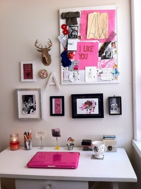 a neutral girlish home office accented with a large gallery wall with hot pink touches and a hot pink laptop