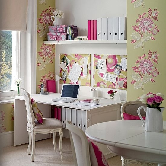 a pretty feminine home office with floral wallpaper, a comfy desk and open shelves, a white table and chic chairs