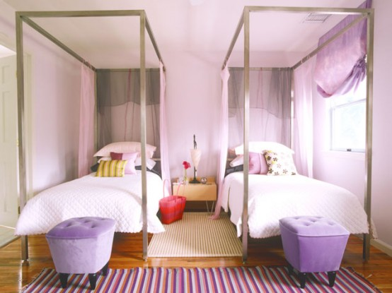 Elegant feminine room in shades of violet. Nice beds and bedside poufs make it look quite unique.