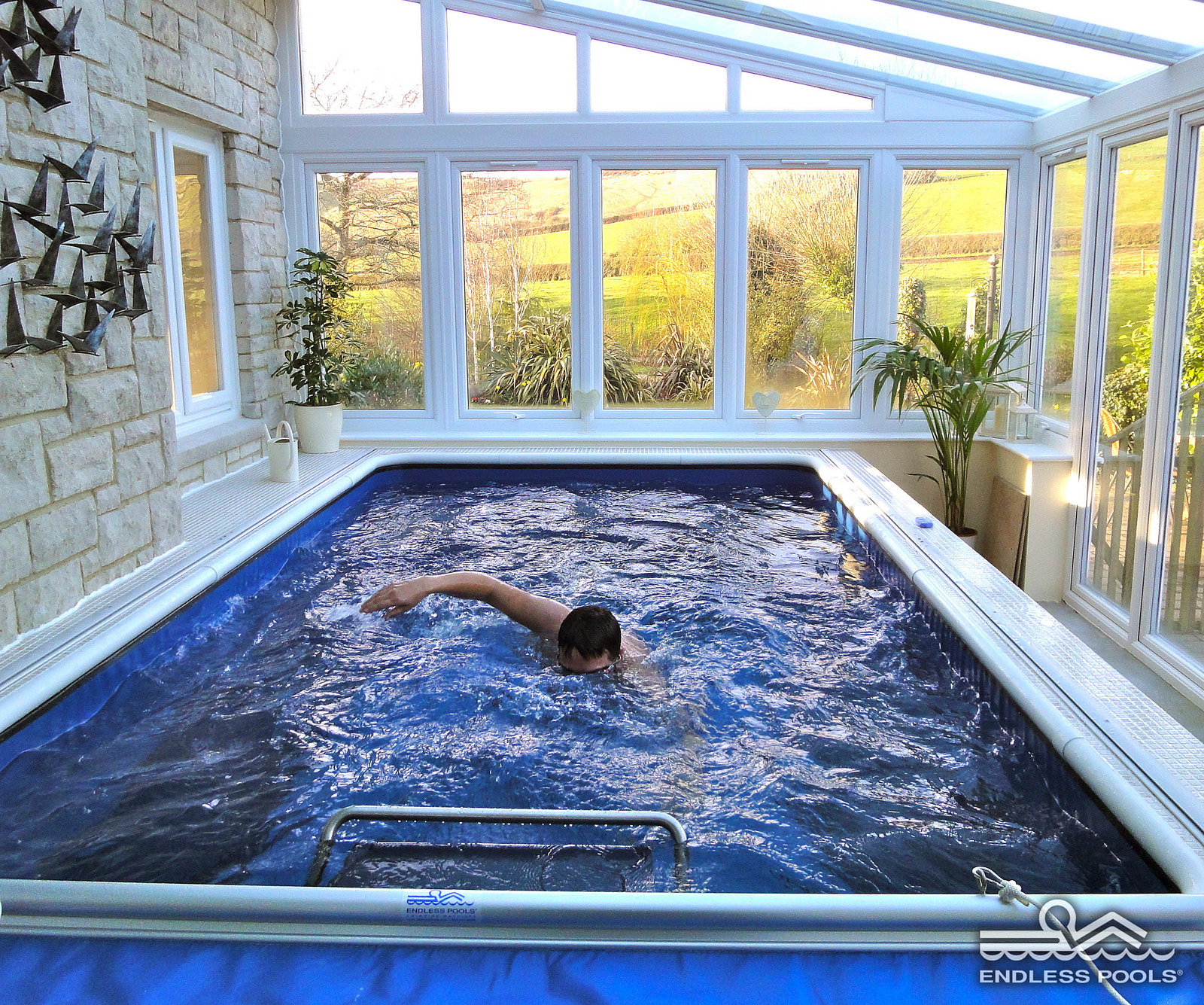even a small sunroom extension could fit a pool where you can swim like pro