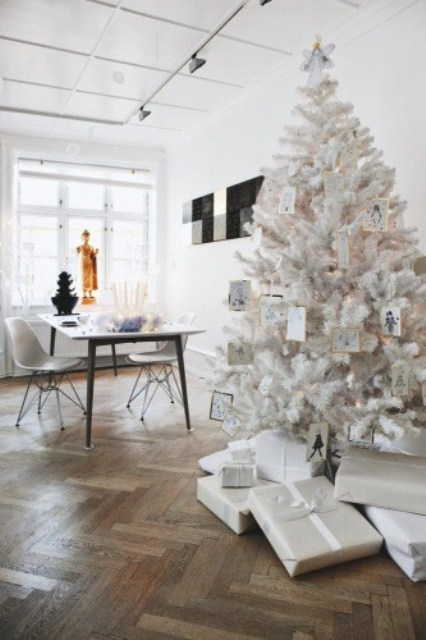 a white Christmas tree and penguin ornaments and lights needs no special decor, it's beautiful and chic itself