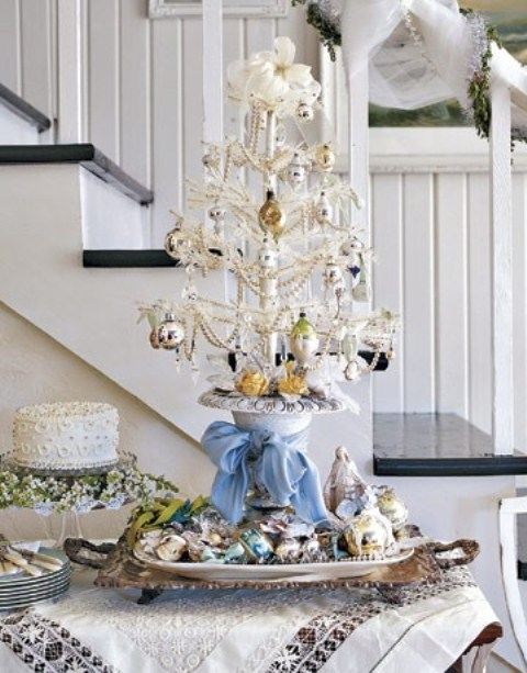 a white tabletop mini Christmas tree with beads, pearls and metallic ornaments is a cool vintage-inspired idea