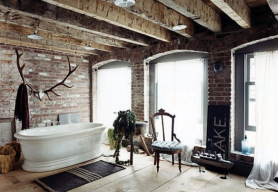 Bathroom with an exposed brick wall should feature a free-standing tub so you could the beautify of the whole wall.