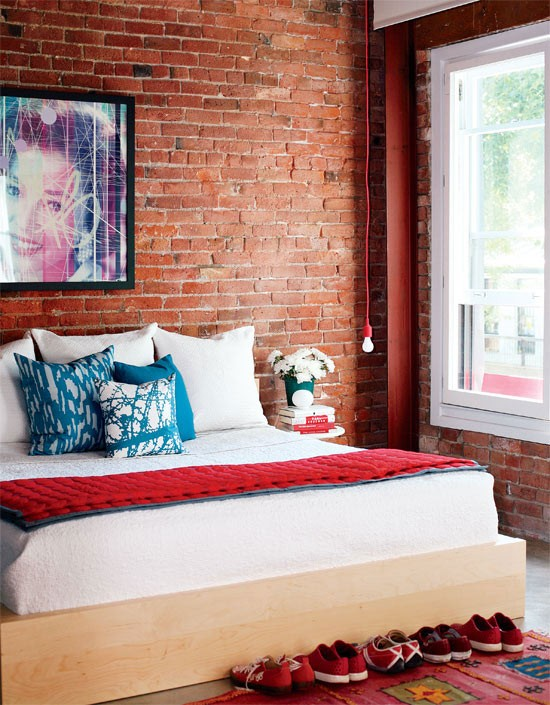 There is no need for a lot of decor elements if your bedroom has an exposed brick wall.