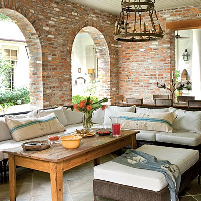 For outdoor areas like patios leaving exposed bricks is even more natural.