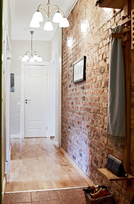 Sealed brick walls are perfect for a hallway because of their durability.