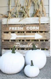 white pumpkins, a wooden pallet with husks can be used for decorating your outdoors in neutral shades