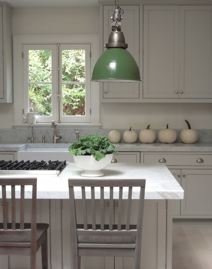 white pumpkins placed on your kitchen table will give a cozy rustic feel to your space