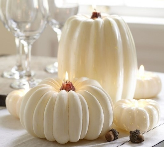 large and small white pumpkin candles look very unusual and very cool and they will refresh your interior for the fall