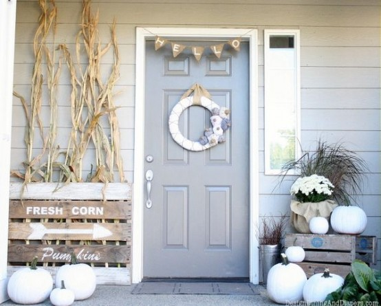 white pumpkins paired with white blooms and husks will make your front porch look rustic and fall-like